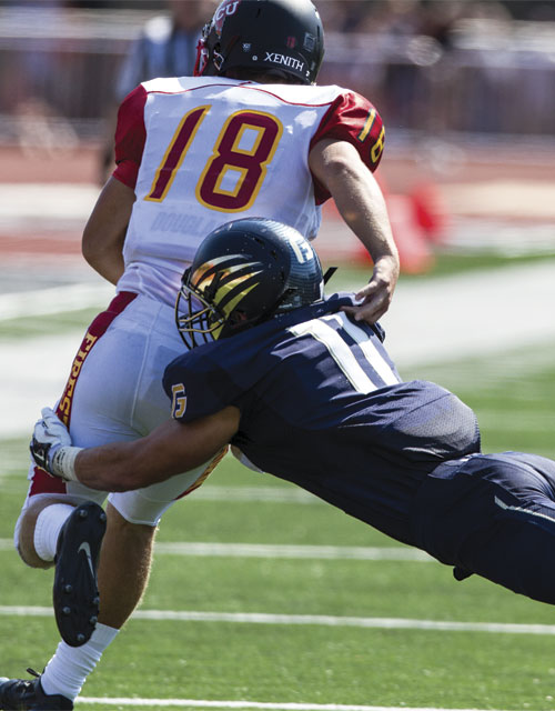 Linebacker Spencer Price dives to wrap up an Arizona Christian receiver.