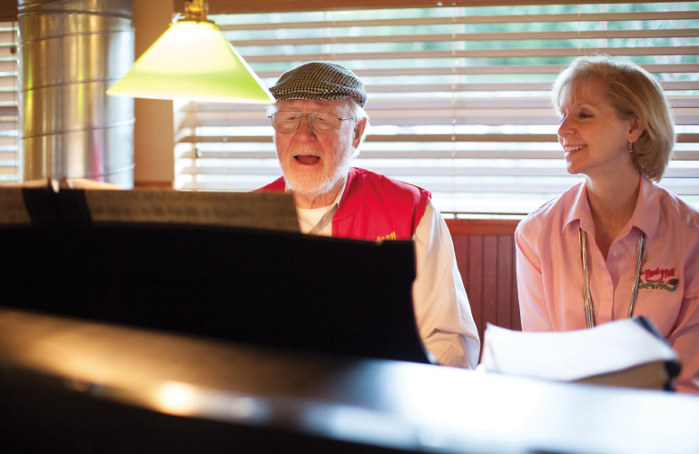 Bob Moore plays a piano in his café at Bob's Red Mill