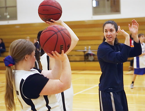 Dacia Heckendorf gives some pointers on shooting technique at a clinic for Special Olympics athletes.