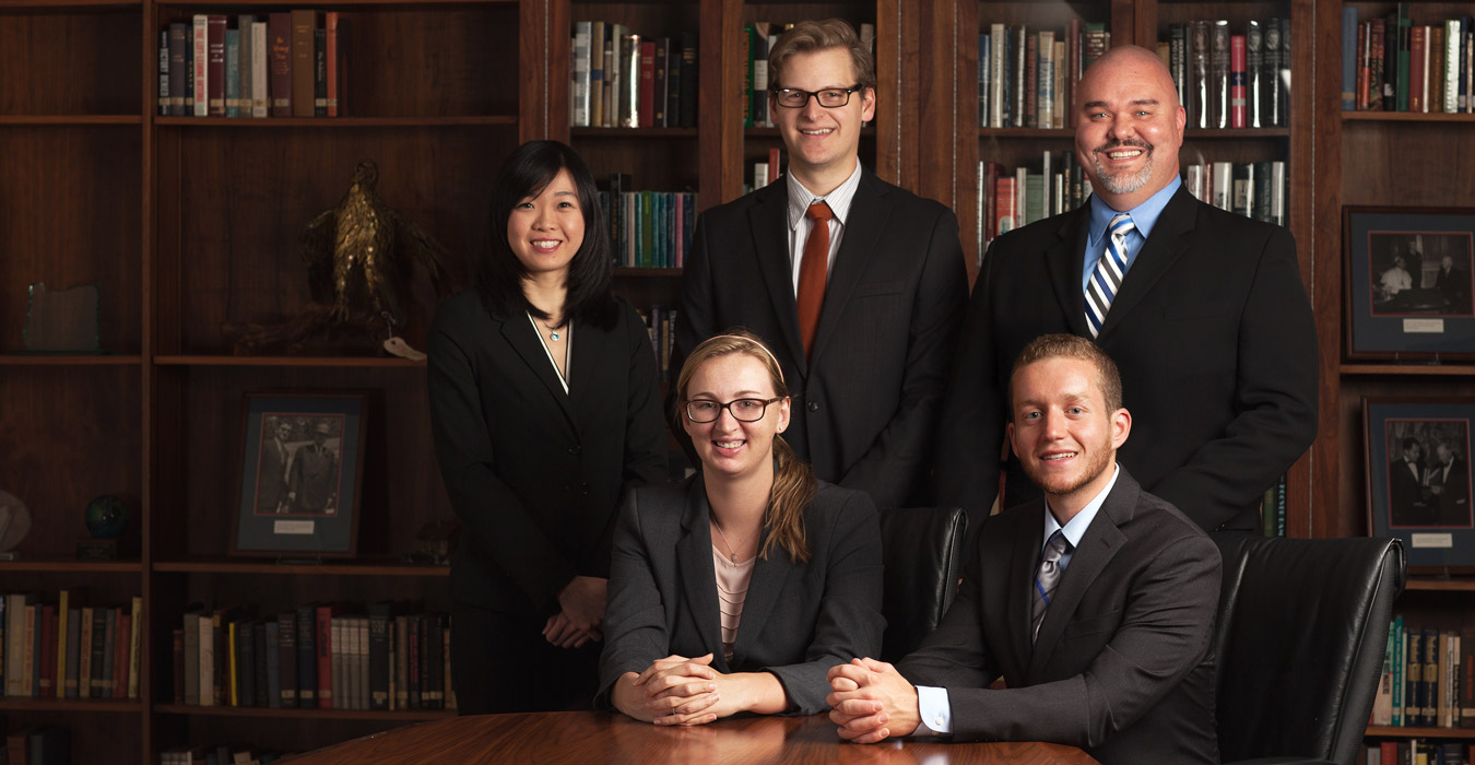 Professor Seth Sikkema and a  select group of accounting  students investigate fraud cases  for victims in need