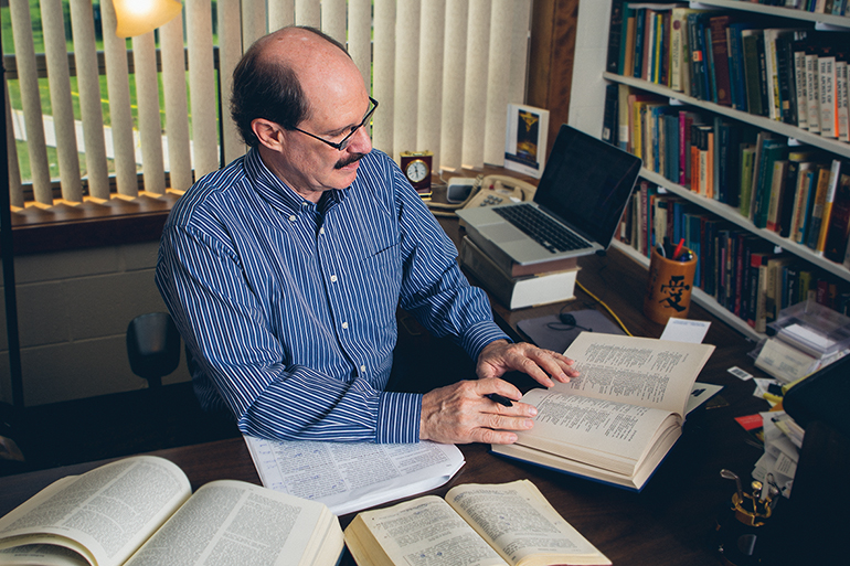 Professor Paul Anderson works to update the world's most widely read translation of the Bible