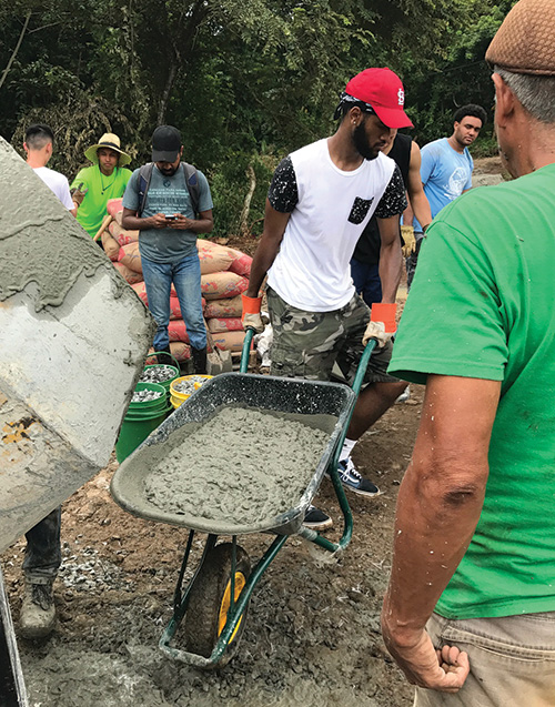 Men's Basketball team builds court in Panama